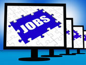 Jobs On Monitors Shows Jobless Employment Or Hiring Online — Stock Photo