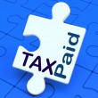 Stock Photo: Tax Paid Puzzle Shows Duty Or Excise Payment
