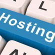 Hosting Key Means Host Or Entertai — Stock Photo