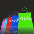 Stock Photo: Percent Reduced On Shopping Bags Shows Bargains