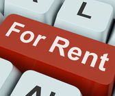 For Rent Key Means Lease Or Renta — Stock Photo