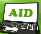 Aid On Laptop Shows Assisting Aiding Help Or Relief — Stock Photo