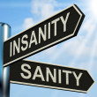 Insanity Sanity Signpost Shows Crazy Or Psychologically Sound — Stock Photo #41155927