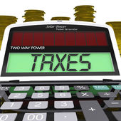 Taxes Calculator Means Taxation Of Income And Earnings — Stock Photo