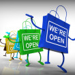 Stock Photo: We're Open Bags Show Shopping Availability and Grand Opening