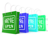 We're Open Shopping Bags Shows New Store Launch — Stock Photo