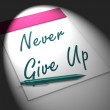 Постер, плакат: Never Give Up Notebook Displays Determination And Motivation