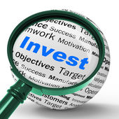 Invest Magnifier Definition Shows Put Money In Real State Or Inv — Stockfoto