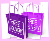 Free Delivery Sign on Shopping Bags Show No Charge To Deliver — Stock Photo