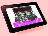 Income Tax Calculator Tablet Means Taxable Earnings And Paying T — Stock Photo