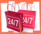 Twenty four Seven Shopping Bags Show Hours Open — Stock Photo