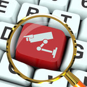 Camera Key Magnified Shows CCTV and Web Security — Stock Photo