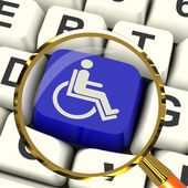 Disabled Key Magnified Shows Wheelchair Access Or Handicapped — Stock Photo