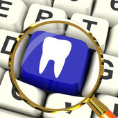 Tooth Key Magnified Means Dental Appointment Or Teeth — Stock Photo