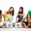Group of young people in hip hop outfits — Stock Photo #30905375