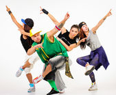 Group of young people in hip hop outfits — Stock Photo