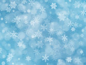 Blue winter background with snowflakes and boke effect — Foto de Stock