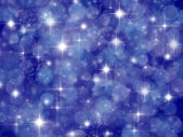 Fundo azul escuro com efeito de boke e estrelas — Fotografia Stock