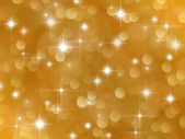 Golden background with boke effect and stars — Stock Photo