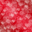 Red valentine background with boke and hearts — Stock Photo