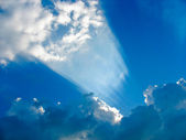 Sun striking through the clouds like a searchlight — Stock Photo