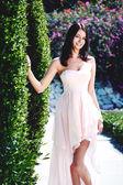 Girl model in pink dress — Stock Photo