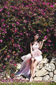 Pink flowers and girl — Stock Photo