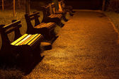 Wooden benches in the park at night — Stock Photo