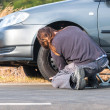 Stock Photo: Young man repairing car outdoors