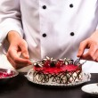 Confectioner and a cake - Stock Photo