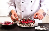 Confectioner and a cake — Stock Photo