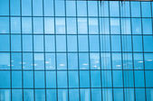 Blue windows with reflection — Stock Photo