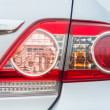 Red backlight of a modern car — Stock Photo