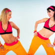 Young fitness instructor girls — Stock Photo #13888329