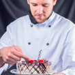 Stock Photo: Confectioner and cake