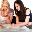 Two beautiful student girls getting ready for school — Stock Photo