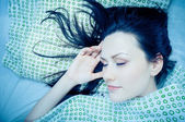 Young woman in the bed — Stock Photo