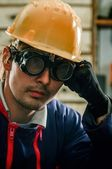 Hard working man in helmet — Stock Photo