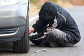 Young man repairing car outdoors — Stock Photo