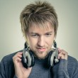 Young man with headphones — Stock Photo #18057087