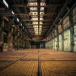 An abandoned industrial interior — Stock Photo