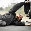 Handsome young man repairing car - Stock Photo