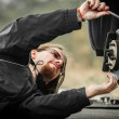 Stock Photo: Handsome young man repairing car