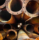 Rusty old pipes stacked up — Stock Photo