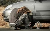Young man repairing the car — Stock Photo