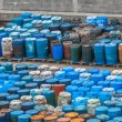 Chemical waste dump with a lot of barrels — 图库照片