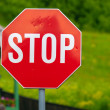 Stop sign closeup photo with nature in background — Stock Photo