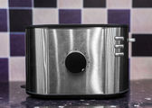 Toaster against purple background — Stock Photo