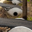Sewage pipes under small road — Stock Photo