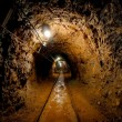Underground mine passage with rails — Stock Photo